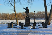 Harriet Tubman's Statue in Bristol Basin Park along a Frozen Delaware River. That's Burlington Island, NJ, in the background.